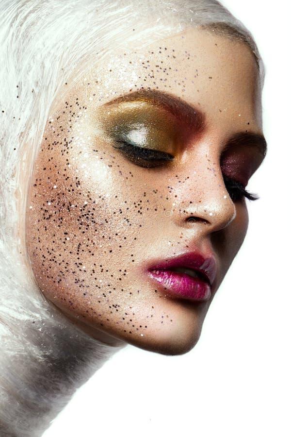 Ciérrese para arriba de cara de la mujer con brillo en cara foto de archivo libre de regalías