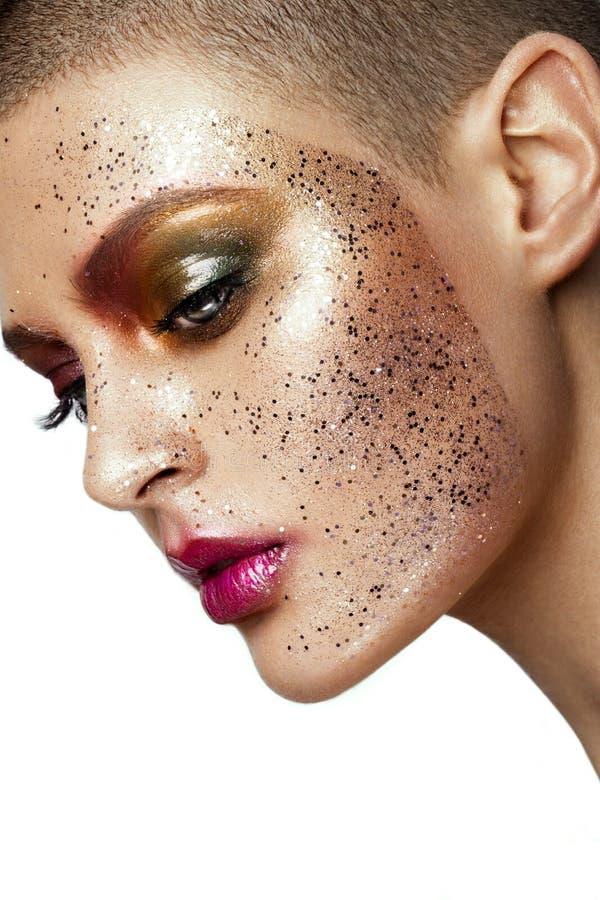 Ciérrese para arriba de cara de la mujer con brillo en cara fotos de archivo libres de regalías