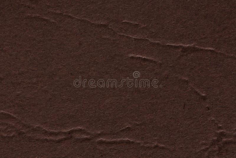 Ciérrese para arriba de fondo de papel marrón oscuro de la textura, puede ser utilizado para los artes imagen de archivo libre de regalías