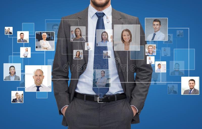 Ciérrese para arriba de hombre de negocios sobre iconos con los contactos imágenes de archivo libres de regalías