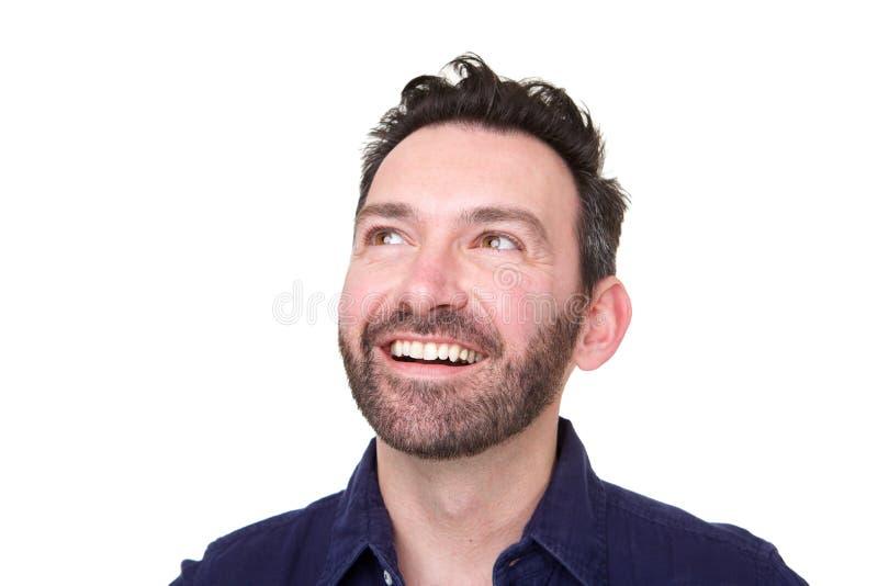 Ciérrese para arriba de hombre feliz con la barba que mira para arriba imagen de archivo libre de regalías