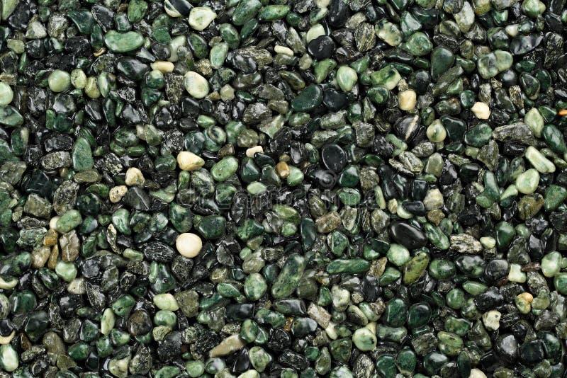 Ciérrese para arriba de la alfombra de piedra natural coloreada verde oscuro Capa de la piedra decorativa El contener resistente  imagen de archivo