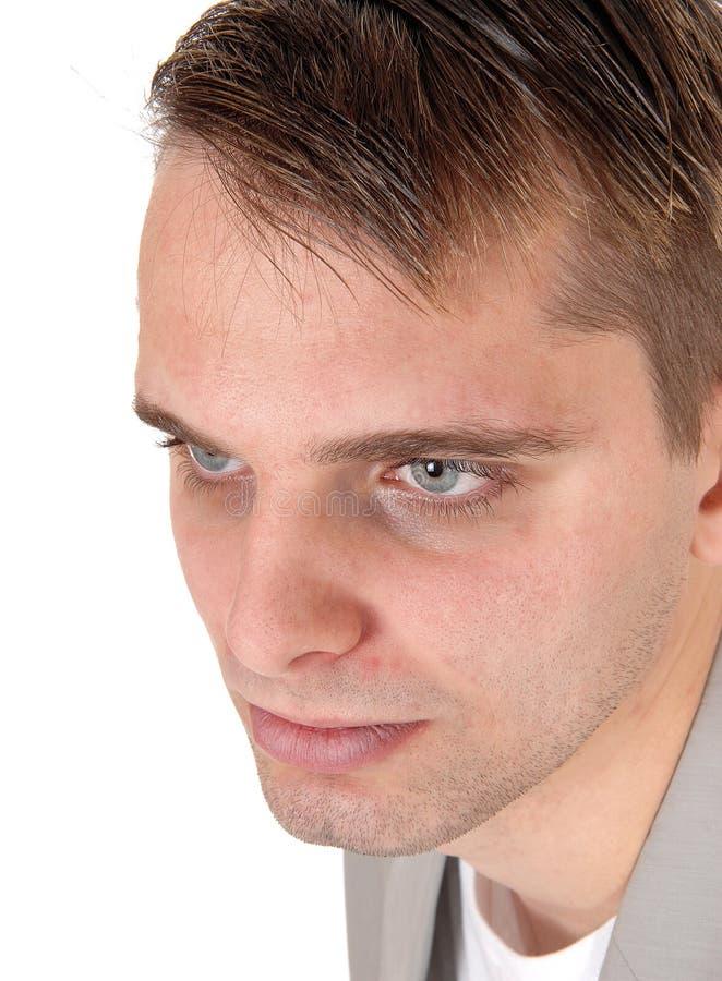 Ciérrese para arriba de la cara de un hombre joven que mira abajo imagen de archivo libre de regalías