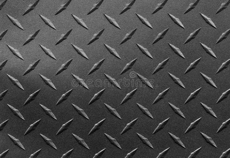 Ciérrese para arriba de la hoja de acero texturizada granosa con el modelo de la placa del diamante, fondo metálico fotografía de archivo