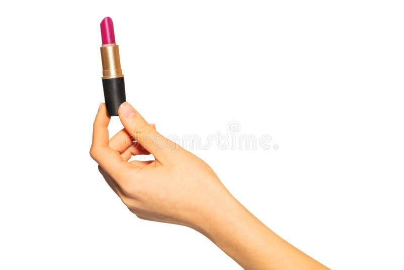 Ciérrese para arriba de la mano de la mujer que sostiene el tubo abierto de la barra de labios imagen de archivo libre de regalías