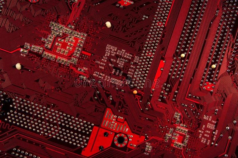 Ciérrese para arriba de la placa roja del circuito foto de archivo libre de regalías