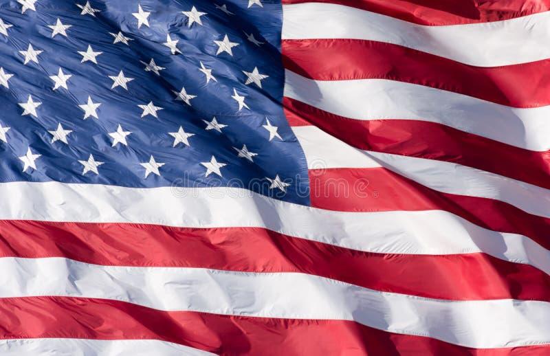 Ciérrese para arriba de las barras y estrellas de la bandera americana imagenes de archivo