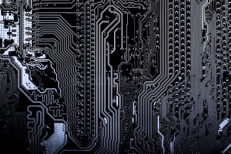 Ciérrese para arriba de los circuitos electrónicos en el tablero de lógica del fondo del ordenador de la tecnología de Mainboard, fotos de archivo libres de regalías