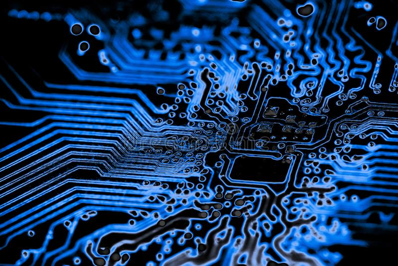 Ciérrese para arriba de los circuitos electrónicos en el tablero de lógica del fondo del ordenador de la tecnología de Mainboard, fotografía de archivo libre de regalías