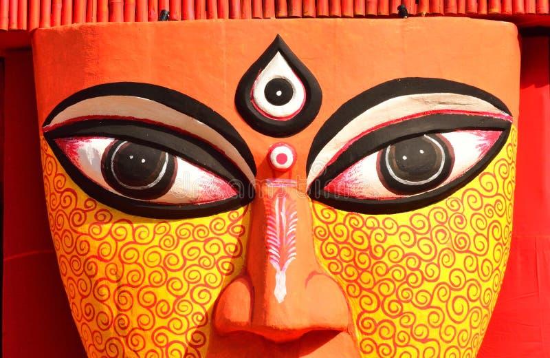 Ciérrese para arriba de los ojos de un ídolo de la diosa hindú Durga imagen de archivo libre de regalías