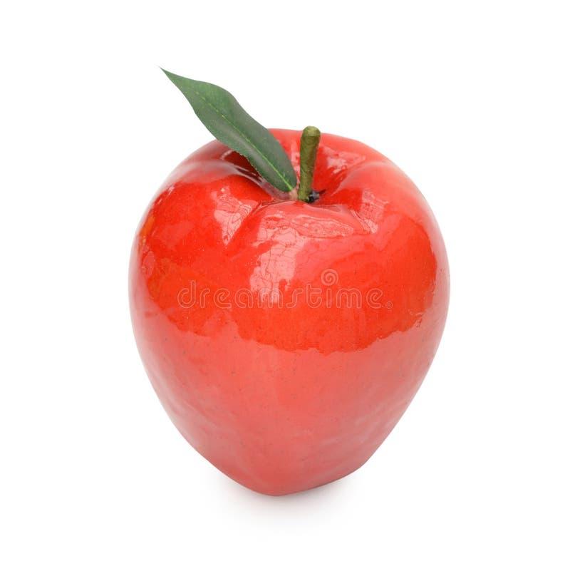Ciérrese para arriba de manzana artificial Aislado en un backgropund blanco fotos de archivo