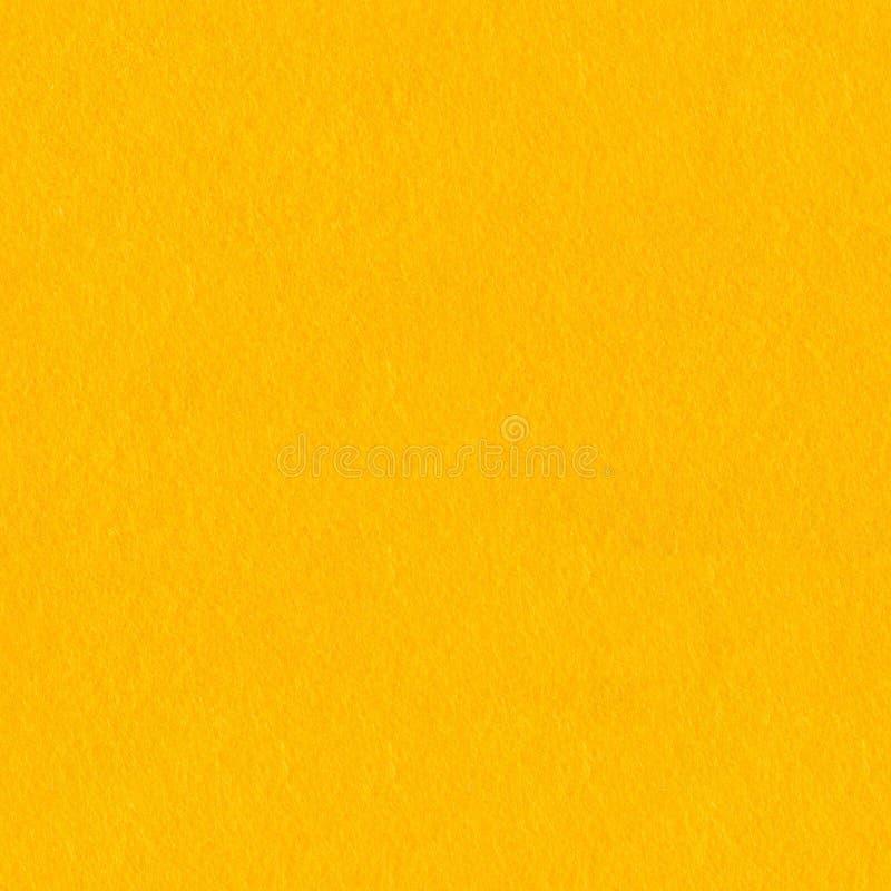 Ciérrese para arriba de tela sentida amarilla brillante El fondo cuadrado incons?til, teja listo foto de archivo libre de regalías
