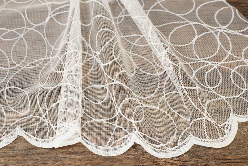 Ciérrese para arriba de Tulle blanca hermosa Muestra escarpada de la tela de las cortinas Textura, fondo, modelo Concepto de la b fotos de archivo libres de regalías