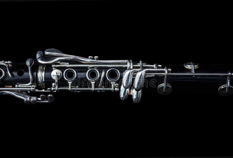 Ciérrese para arriba de un clarinete que se acuesta fotografía de archivo