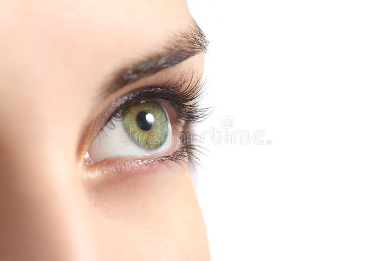 Ciérrese para arriba de un ojo verde de la mujer fotos de archivo