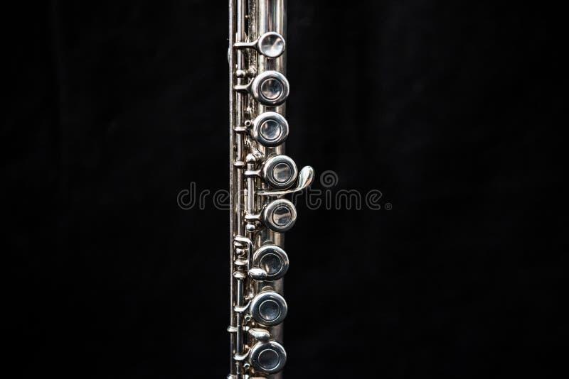 Ciérrese para arriba de una situación de la flauta transversal foto de archivo