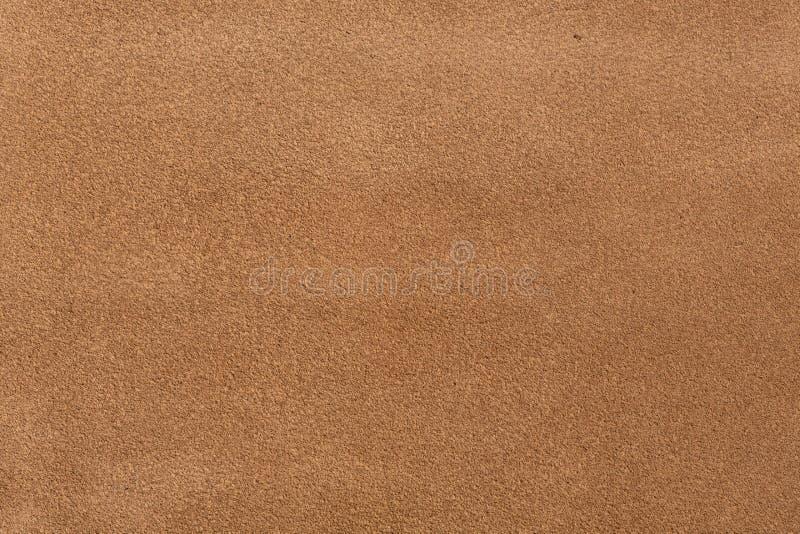 Ciérrese para arriba de una textura de cuero anaranjada imagenes de archivo