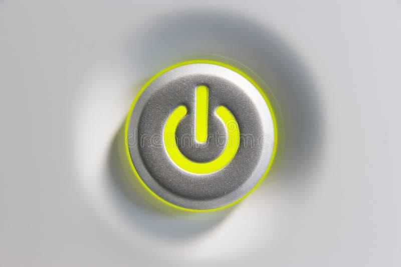 Ciérrese para arriba del botón de la potencia imagenes de archivo