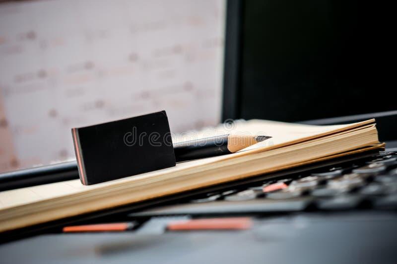 Ciérrese para arriba del cuaderno con el lápiz y el borrador en el top fotos de archivo libres de regalías