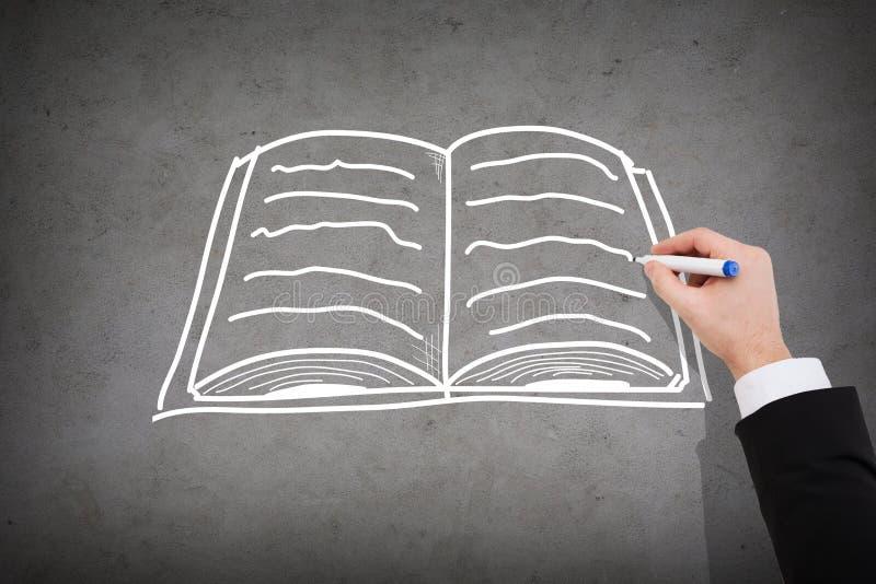 Ciérrese para arriba del cuaderno de dibujo del hombre de negocios fotos de archivo