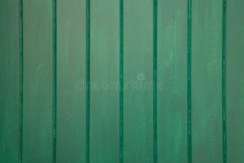 Ciérrese para arriba del fondo de madera pintado verde - textura fotografía de archivo