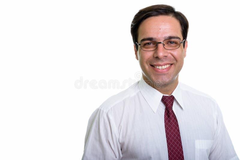 Ci?rrese para arriba del hombre de negocios persa feliz joven que sonr?e con eyeglas imágenes de archivo libres de regalías