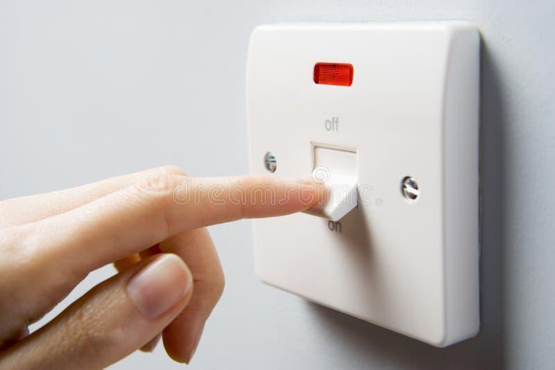 Ciérrese para arriba del interruptor que es activado fotos de archivo