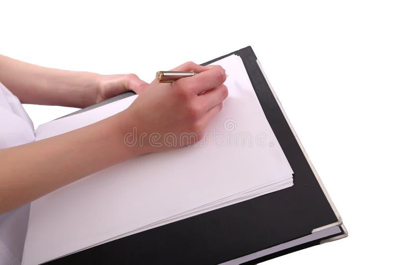 Ciérrese para arriba del papel femenino de la prescripción de la escritura del doctor imágenes de archivo libres de regalías