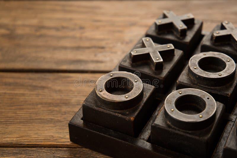Ciérrese para arriba del tic Tac Toe, de nadas y de cruces, de juego de X y de O fotos de archivo libres de regalías