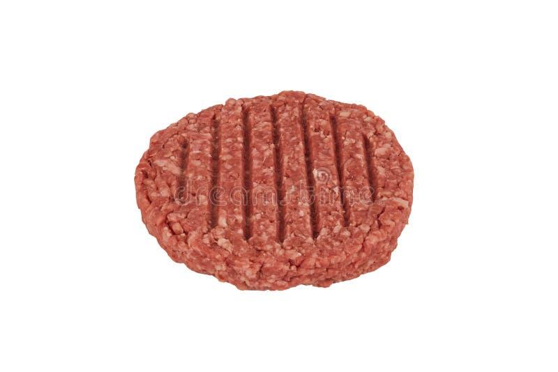 Ciérrese para arriba en una empanada cruda del filete de la hamburguesa de la carne picada fotografía de archivo libre de regalías