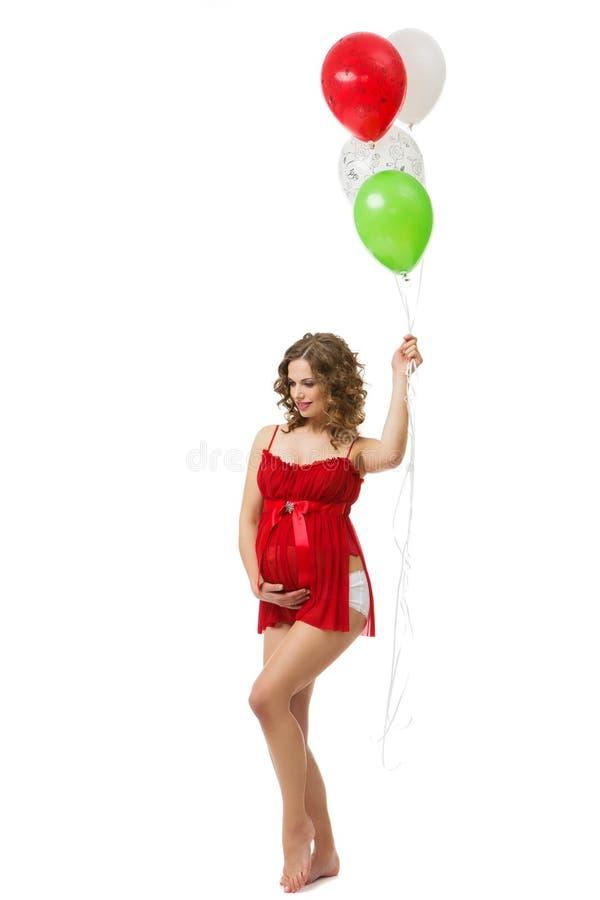 Ciężarna dziewczyna z balonami zdjęcie royalty free