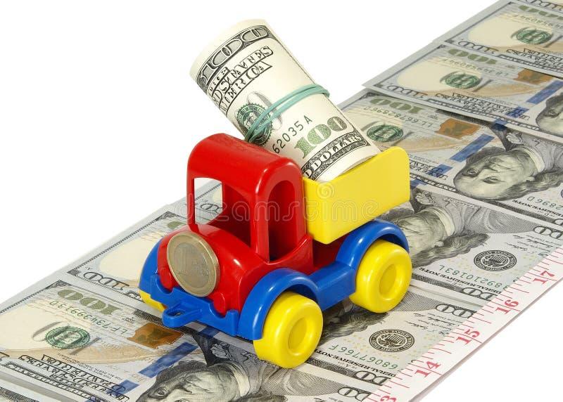 Ciężarowa zabawka na drodze od pieniądze zdjęcie royalty free