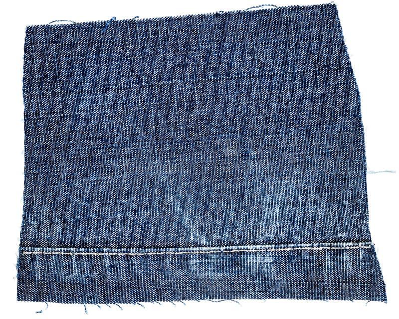 Cięcie niebiescy dżinsy tkanina zdjęcia royalty free