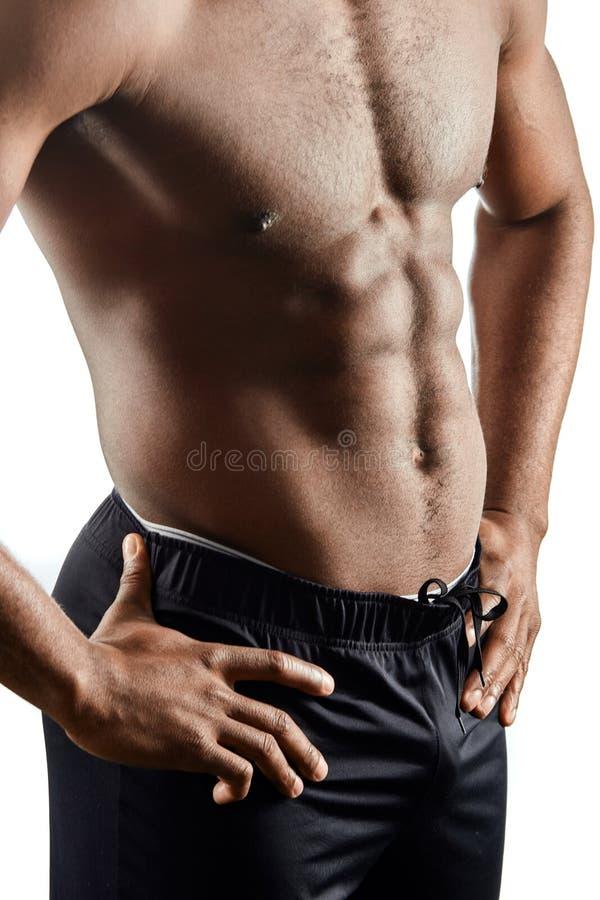 ci?rrese encima de la foto cosechada foco en el ABS del deportista fotografía de archivo libre de regalías