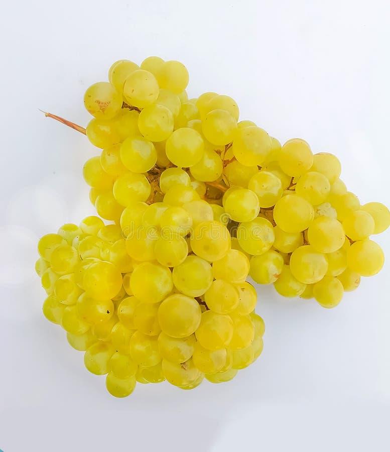 Ci?rrese para arriba de uvas verdes fotografía de archivo