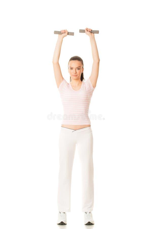 ciało boczne studia świetle całej kobiety tumany izolować się białych young pracy zdjęcia stock