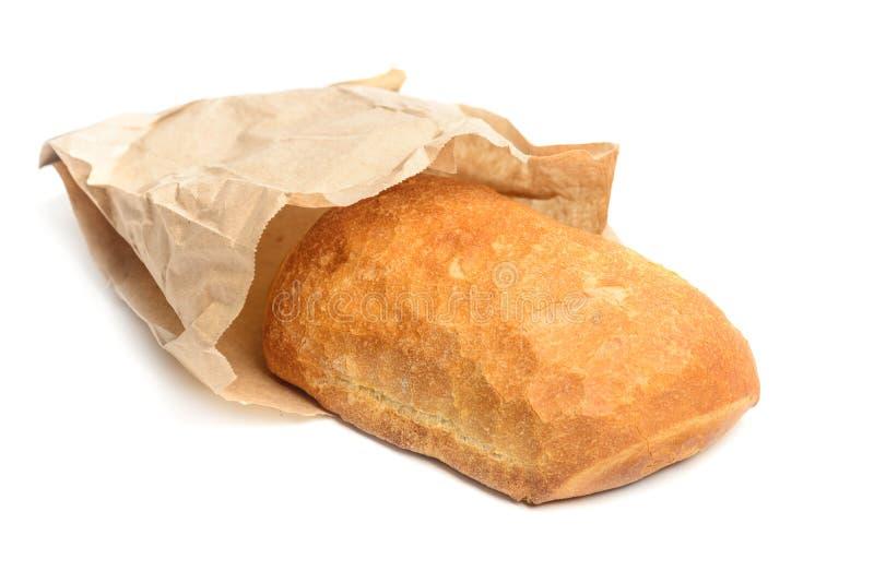 Ciabatta bröd slogg in i papper som isolerades på vit arkivbilder