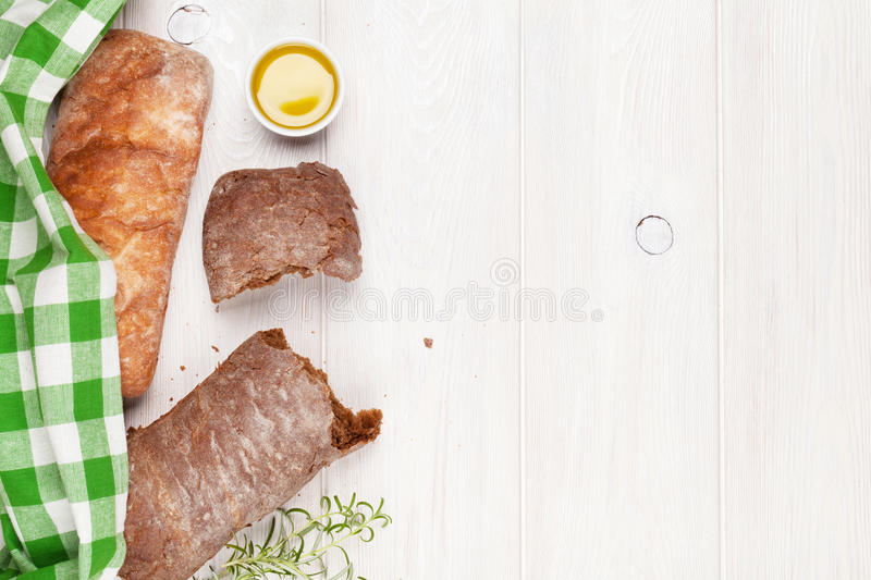 Ciabatta with olive oil and rosemary royalty free stock photos