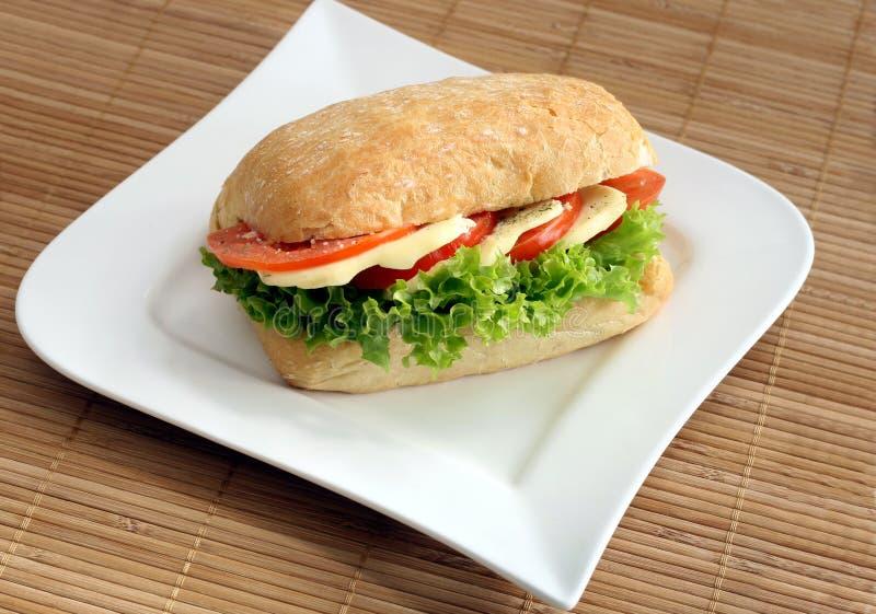 Ciabatta sandwich. With mozzarella and tomatoes stock image
