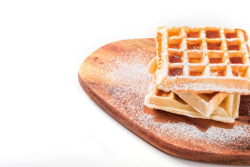 Cialde belghe con lo zucchero a velo e lo sciroppo d'acero fotografia stock libera da diritti