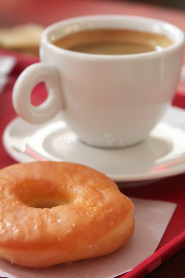 Ciambella e caffè fotografia stock