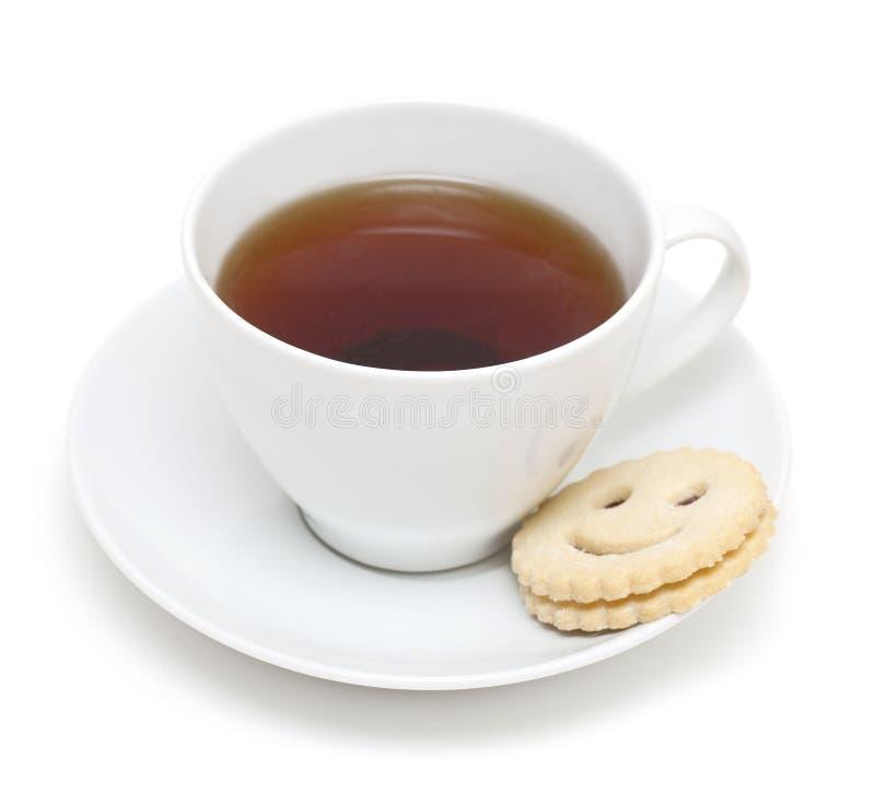 ciastka filiżanki uśmiechnięta herbata fotografia stock
