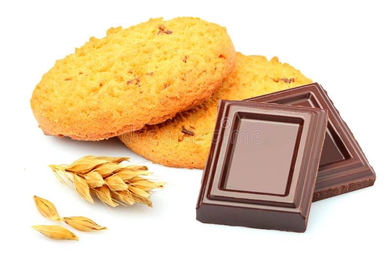 Ciastka z czekoladą i kolcem odizolowywającymi obrazy royalty free