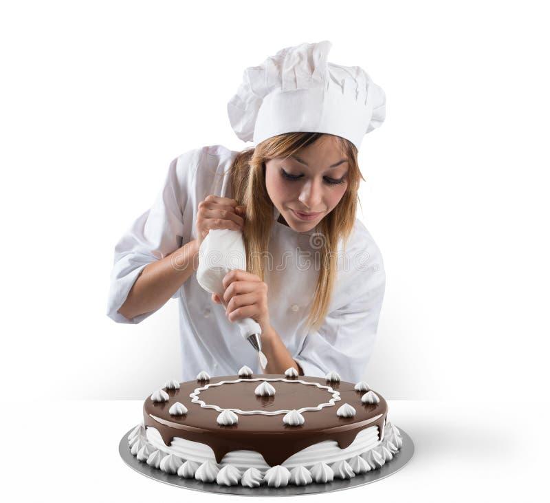 Ciasto kucharz przygotowywa tort zdjęcie royalty free