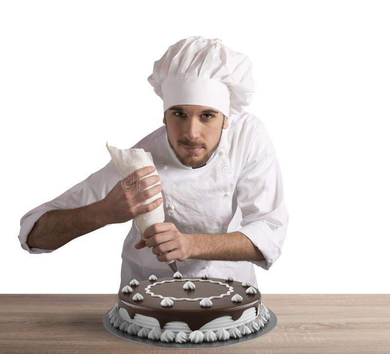 Ciasto kucharz przygotowywa tort fotografia royalty free