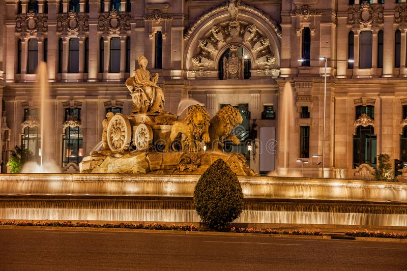 Cibeles Fountain and Cybele Palace in Madrid. Cibeles Fountain at dusk in city of Madrid, Spain, the Cybele Palace Palacio de Cibeles, Palacio de Comunicaciones royalty free stock photos