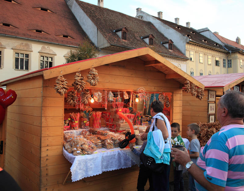 CibinFest Market, Large Square, Sibiu. Sibiu, Romania - September 28, 2012: Small shop at CibinFest selling different kind of sweets like pretzels, gingerbread royalty free stock photo