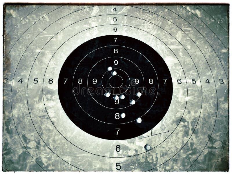 Cible d'oeil de Taureau avec le trou de balle photo libre de droits