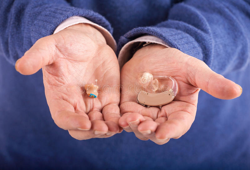 CIC and BTE hearing aids royalty free stock image