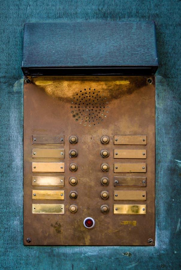 Cicalino d'ottone d'annata del citofono immagini stock libere da diritti